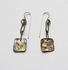 Carmen Goldfinds dangler earrings